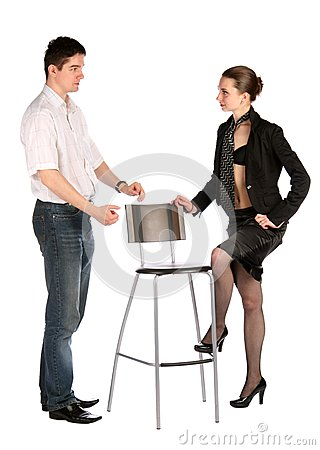 Girl in black and man in white at the stool.