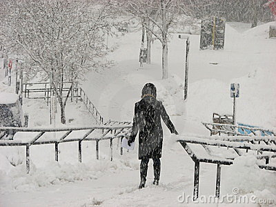 A girl in black outfit in heavy Snow Storm  at UWM Editorial Stock Photo