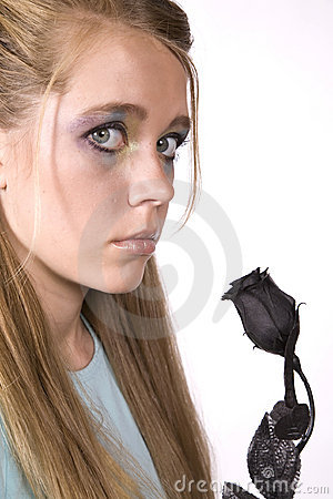 A girl with a black rose