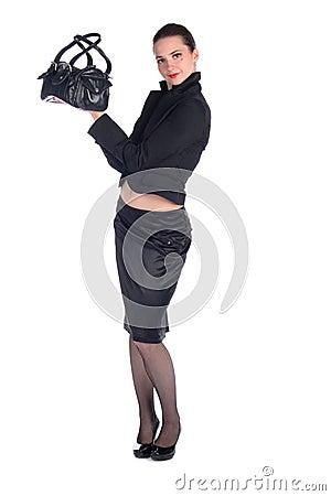 Girl in black suit show bag.