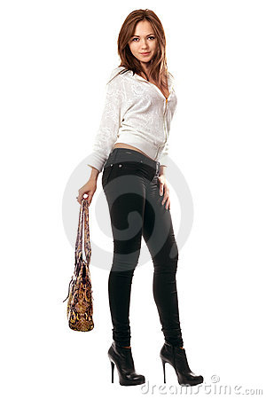 Girl in black tight jeans with a handbag