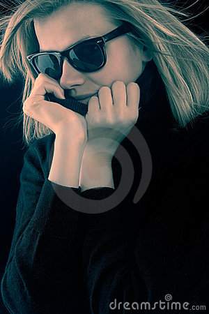 Girl in a black turtleneck with retro sunglasses