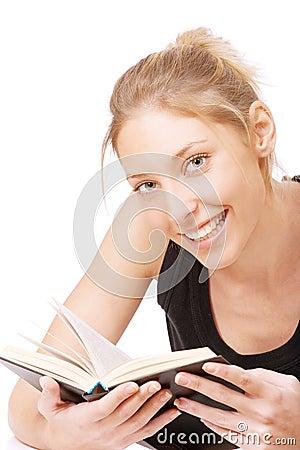 Girl in black vest reads book
