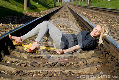 Girl blonde lying on the rails