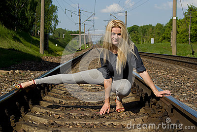 Girl blonde sitting on the rails