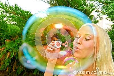 Girl blow bubbles