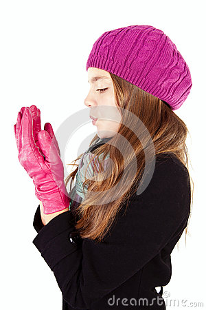 Girl blow on numb hands isolated over white