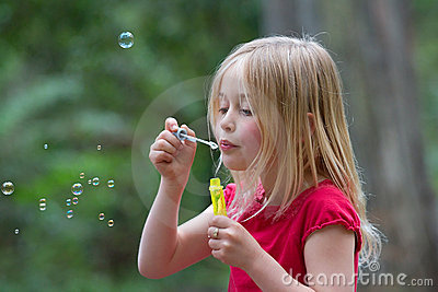 Girl blowing bubbles.