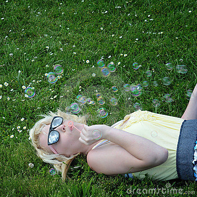 Free Girl Blowing Bubbles In Grass Stock Photography - 14811772