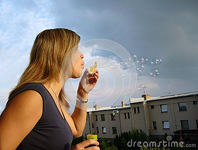 A girl blowing soap-bubbles
