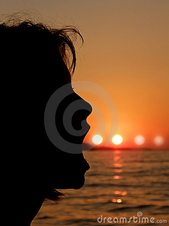 Girl blowing a sun bubbles