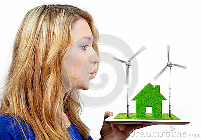 Girl blowing on the wind turbines