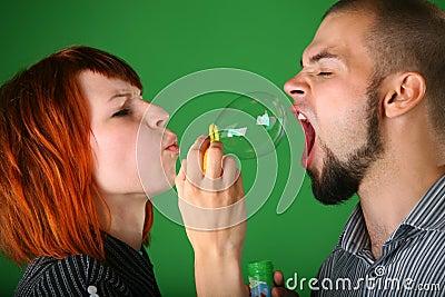 Girl blows soap bubble
