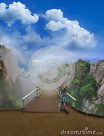 Girl in blue dress on a bridge