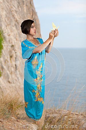 Girl in blue indian dress on seacoast