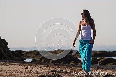 Girl in blue skirt on beach