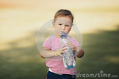 Girl with bottle of mineral water