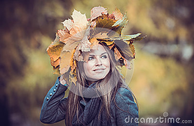 Girl with bouquet in autumn park