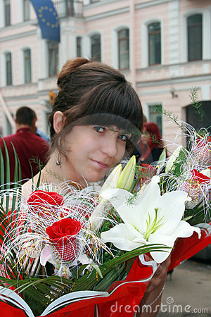 Girl with bouquet flowers