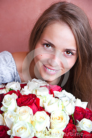 A girl with a bouquet of roses.
