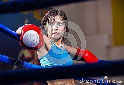 Girl boxer in boxing ring