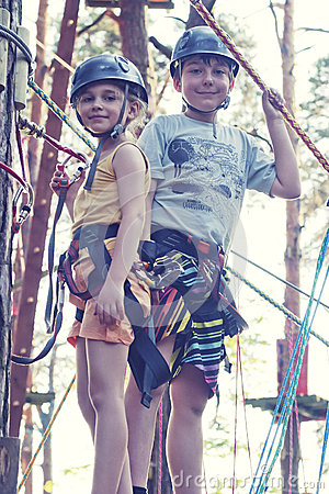 Girl and boy in adventure park