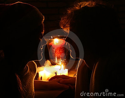 Girl and boy in candleligt
