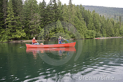 Girl and boy canoeing