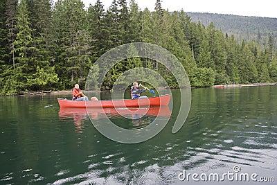Girl and boy canoeing