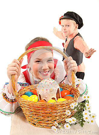 Girl and boy with Easter eggs and a holiday cake