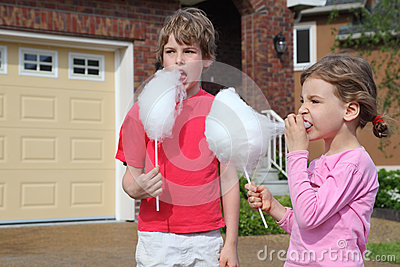Girl and boy eat cotton candy