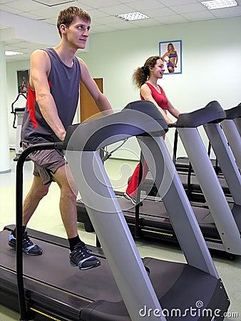 Girl and boy in health club