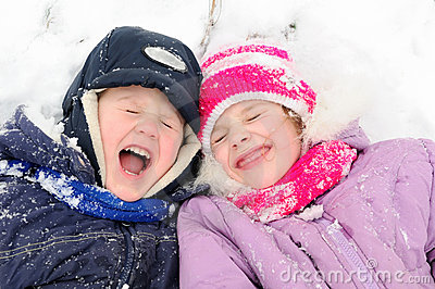 Girl and boy laughing at snowy winter
