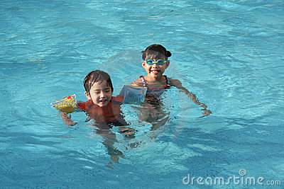 Girl & boy in the pool