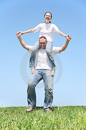 Girl on boy s shoulders