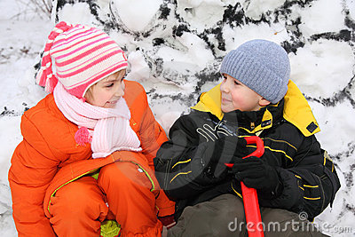 Girl and boy at snow wall
