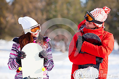 Girl and boy with snowboards