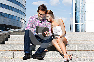 Girl with boy at the University of  tablet computer