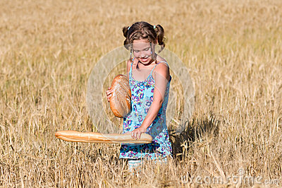 Girl with bread in a cornfield