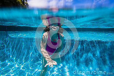 Girl Breath Underwater Pool