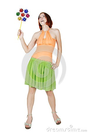 Girl in bright clothes holding pinwheella