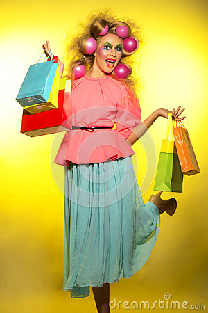 Girl with bright makeup and purchase in hands Stock Photo