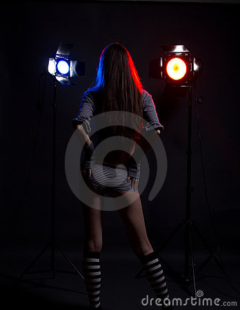Girl with bright studio flashes