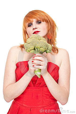 Girl with broccoli in red dress isolated
