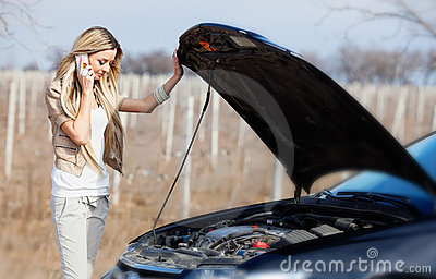 Girl with broken car
