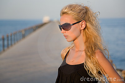 Girl with bronze tan on a pier