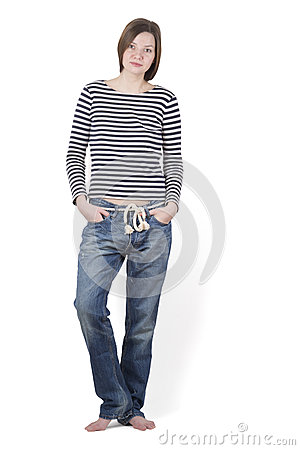 Free Girl Brunette Standing Barefoot In A Striped Shirt And Blue Jeans. Royalty Free Stock Image - 66944796