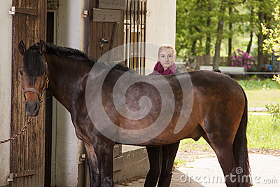 Girl brushes her pony