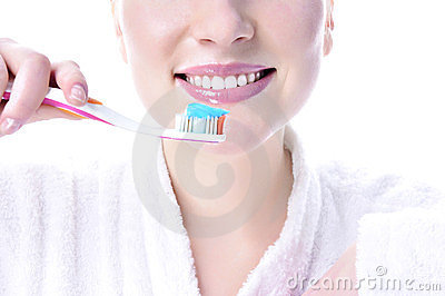 Girl brushes her teeth