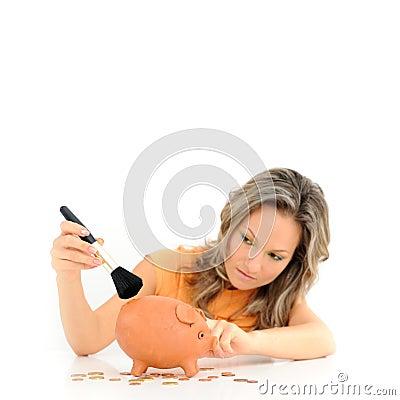 Girl brushing her piggy bank